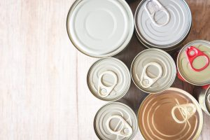 Canned food items on a wooden table